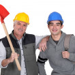 Construction worker and his apprentice — Stock Photo #11855172
