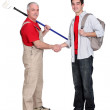 Decorator shaking hands with a young man — Stock Photo