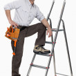Stock Photo: Handymclimbing ladder
