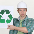 Builder holding universal recycling symbol — Stock Photo #11855805