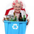 Old woman recycling bottles and cans — Stock Photo