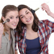 Stock Photo: Girls applying makeup
