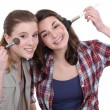 Girls applying makeup — Foto Stock #11856326