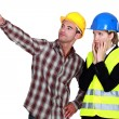 Female architect looking appalled and male builder — Stock Photo