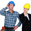 Stock Photo: Architect flirting with builder