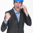 Angry businessman shouting on his cell — Stock Photo #11858139