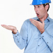 Engineer looking at his hand in amazement — Stock Photo #11858180