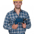 Builder with a power drill — Stock Photo