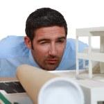 Architect inspecting model housing — Stock Photo #11858615