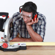 Carpenter using miter saw — Stock Photo #11858621