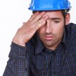 Engineer with a headache - Stock Photo