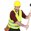 Tradesman hitting an object with a mallet — Stock Photo #11858782