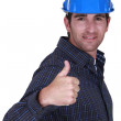 Builder giving ok gesture - Stockfoto