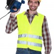 Stock Photo: Mason with circular saw