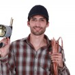 Plumber with blow-torch and copper pipe — Stock Photo #11859158