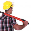 Tradesman carrying a pair of large clippers on his shoulder — Stock Photo #11859264