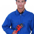 Worker holding red wrench — Stock Photo #11859268