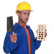 Mason holding brick and trowel — Stock Photo #11859428