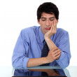 Bored man sat by closed laptop — Stock Photo #11859899