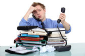 An overwhelmed businessman. — Stock Photo