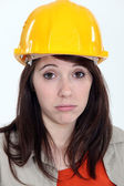 Exhausted young female builder — Stock Photo