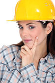 Tradeswoman contemplating life — Stockfoto