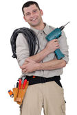 Friendly electrician with a drill — Stock Photo