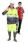 Builder stood with eager new apprentice — Stock Photo