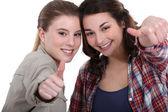 Young women giving the thumb's up — Stock Photo