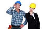 Architect flirting with builder — Stock Photo