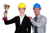A couple of architects holding a trophy. — Stock Photo