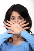 Woman hiding her mouth — Stock Photo