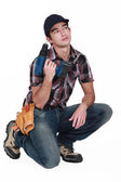 Pensive builder holding drill — Stock Photo