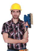 Portrait of a handyman holding a sander — Stock Photo