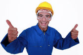 Elated tradesman giving two thumb's up — Stock Photo