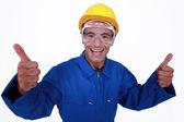 Elated tradesman giving two thumb's up — Stock Photo