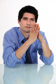 Businessman with his hands pressed together — Stock Photo