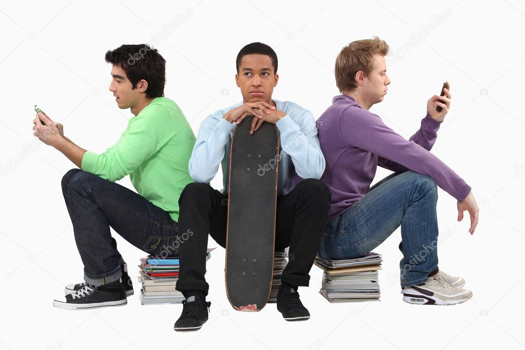 Annoyed young man waiting for his friends to finish texting — Stock Photo #11856037