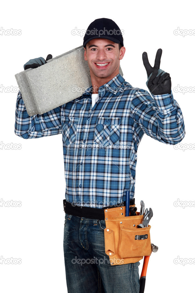 Bricklayer making peace gesture — Stock Photo #11856720