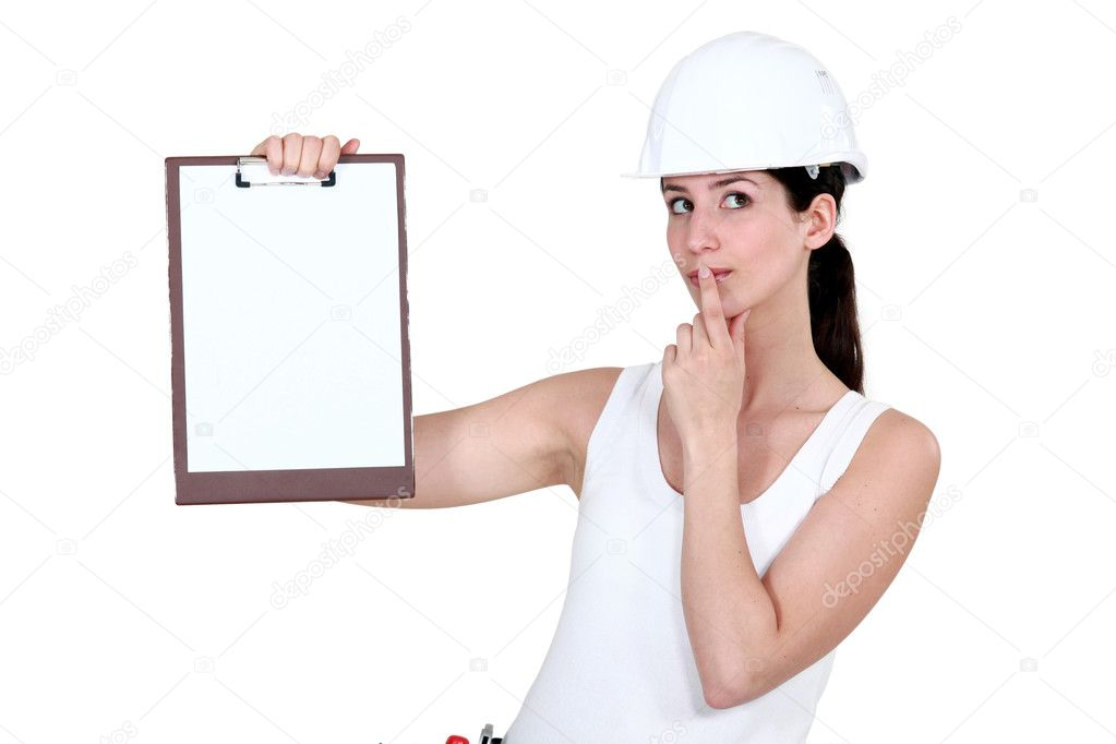 Woman with clip-board making shush gesture  Stock Photo #11857145