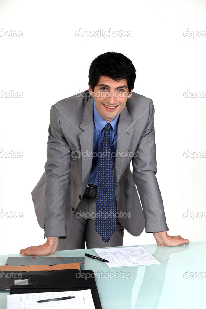 Executive hands resting on table  Stock Photo #11859918