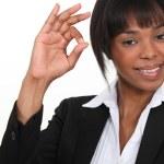 An African American businesswoman gesturing an ok sign. — Stock Photo