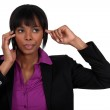 Woman putting finger in ear during call — Stock Photo #11860605