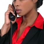 Businesswoman using a landline — Stock Photo #11860723