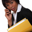 Female lawyer with documents and mobile — Stock Photo
