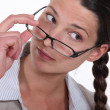 A businesswoman taking her glasses off. — Stock Photo #11861247
