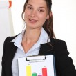 Woman holding up the results of a poll — Stock Photo #11861512