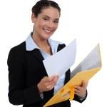 Woman holding folder — Stock Photo