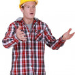 A stunned tradesman — Stock Photo