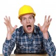Craftsman in a state of shock — Stock Photo